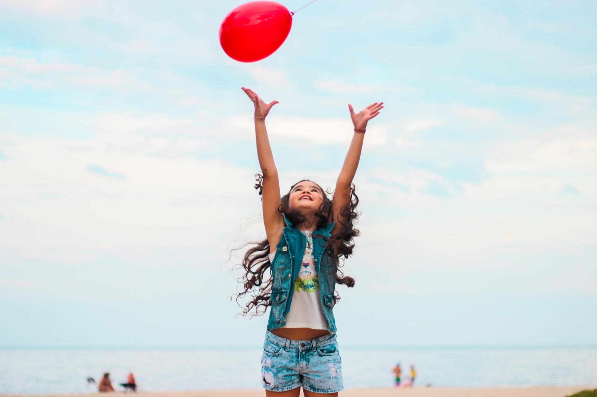 Happy girl with a ballon